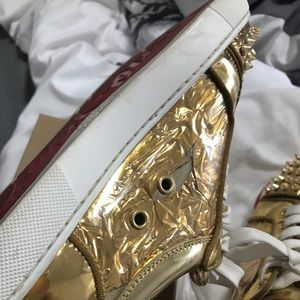 Size 6.5 Christian Louboutin gold, spike sneakers